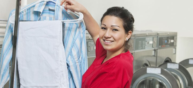 A woman holding up laundry