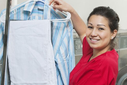 A woman holding clean laundry